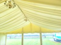 lined party tent with clear window panels